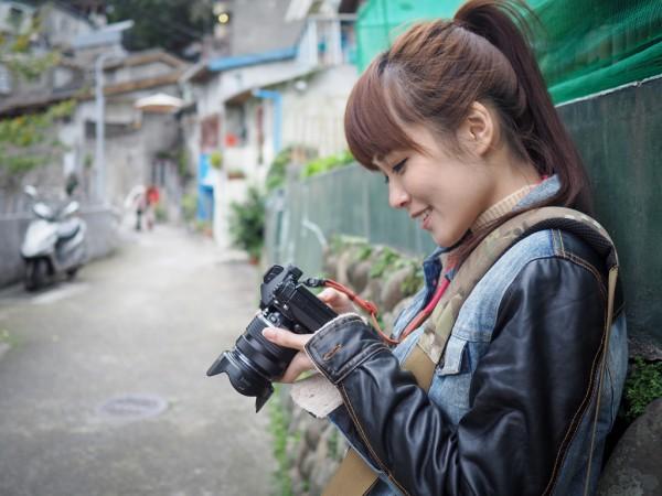 女性 カメラ